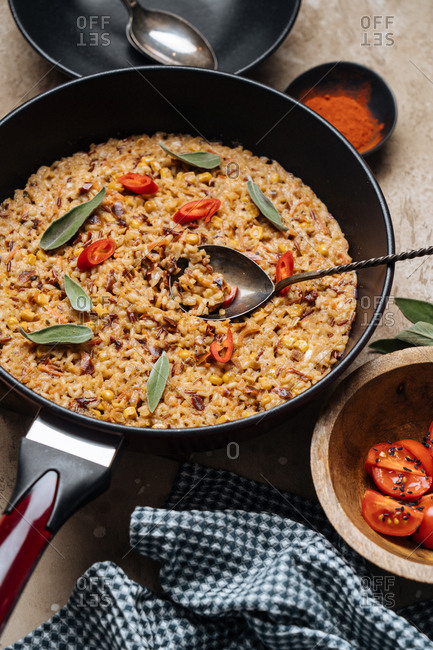 Rice, pepper, and sage dish in a frying pan ready to serve