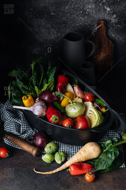 Variety of fresh vegetables in a black pot
