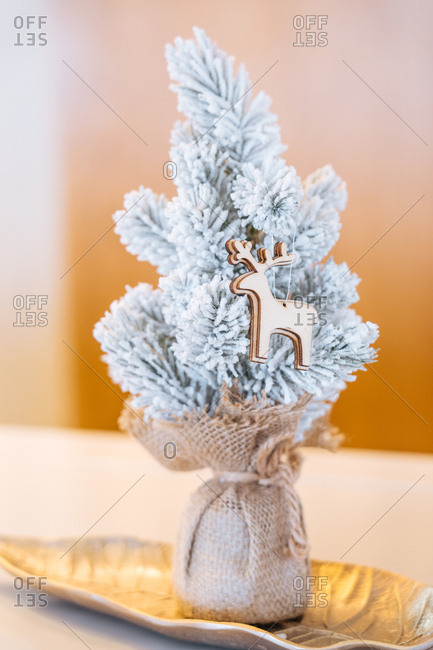 Gold reindeer on a small white tree