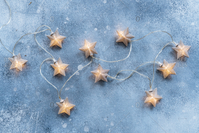 Star shaped lights on blue background