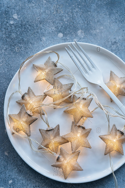 Star lights on a plate on blue background