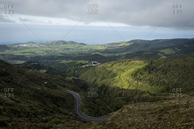 Road among the green hills of Sao Miguel