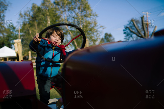 Boy playing on a tractor