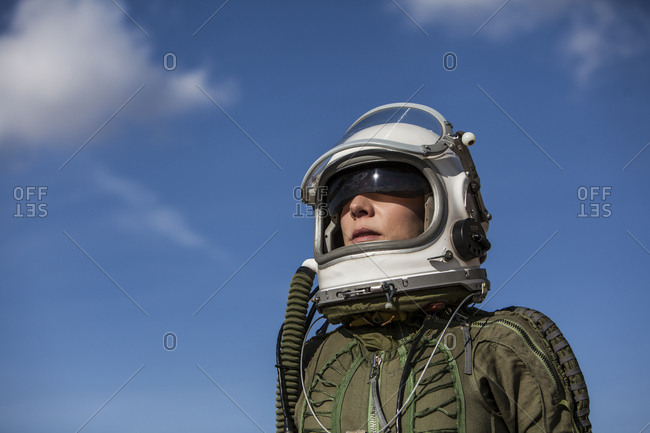 beautiful and young blonde dressed as russian aeronautic pilot, portrait of face in open visor helmet