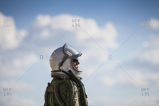 beautiful and young blonde dressed as russian aeronautic pilot, lateral view of the helmet