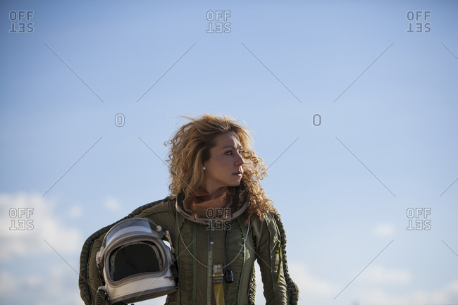 beautiful and young blonde dressed as russian aeronautic pilot, portrait Front half-length portrait without a helmet