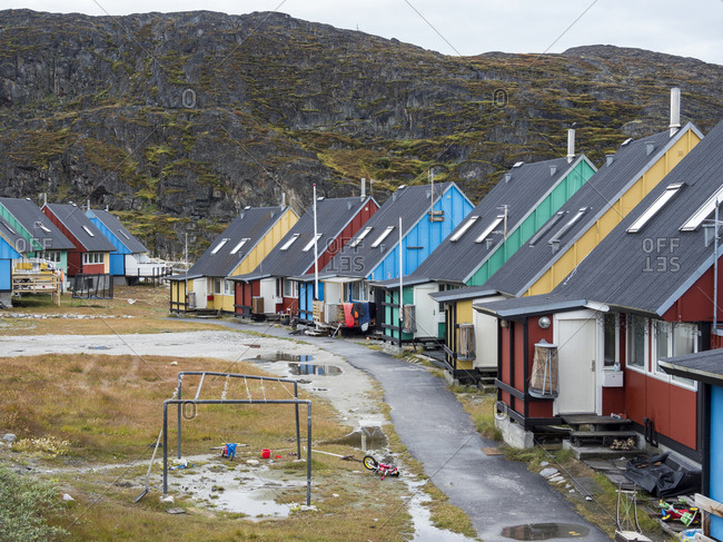 Modern living quarter with colorful houses. Town Ilulissat at the shore of Disko Bay in West Greenland. The icefjord nearby is listed as UNESCO World Heritage Site.