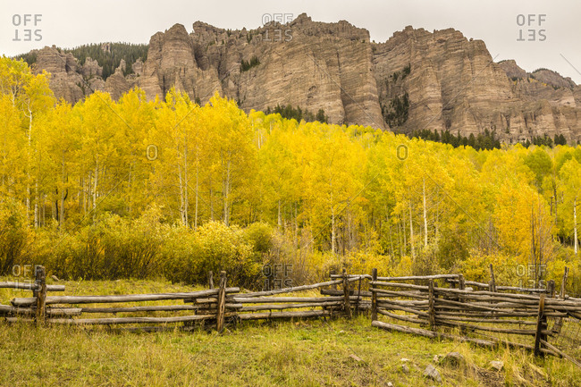 USA, Colorado, Gunnison National Forest. Split rail fence and formations.