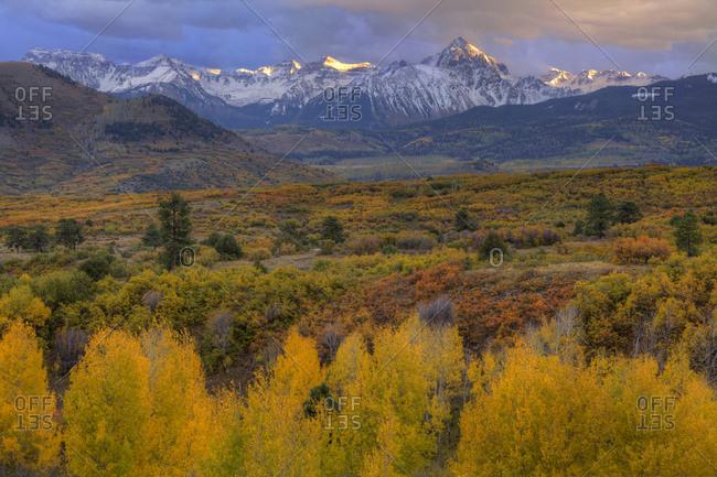 USA, Colorado, San Juan Mountains. Mountain and valley landscape at sunset.