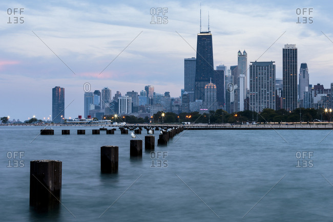 USA, North America, Illinois - September 24, 2015: Seagulls sit atop metal pylons in the waters of Lake Michigan.