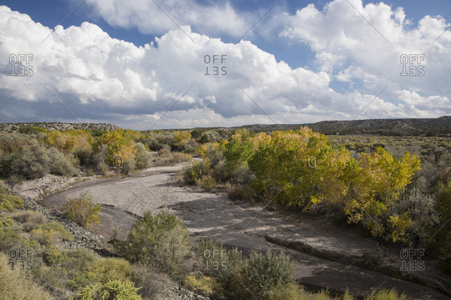 USA, New Mexico. A riverbed winding through the desert along the Turquoise Trail Scenic Byway between Santa Fe and Albuquerque.
