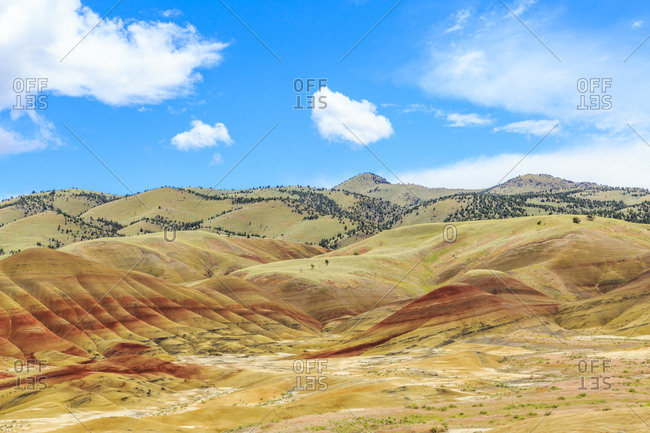 USA, Oregon, Redmond, Bend, Mitchell. Series of low clay hills striped in colorful bands of minerals, ash and clay deposits.