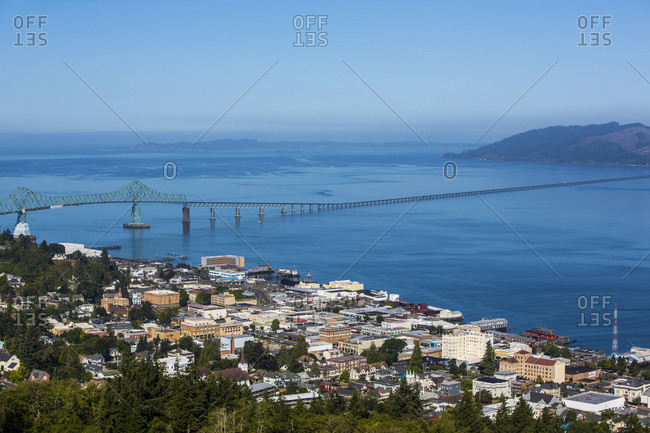 Astoria, Oregon. Aerial view of the town of Astoria, Columbia River, the Pacific Ocean, and the Astoria Megler Bridge