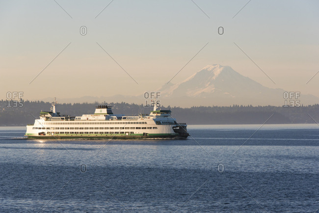 USA, Washington State. Mt. Rainier in morning light. Calm Puget Sound for ferry crossing
