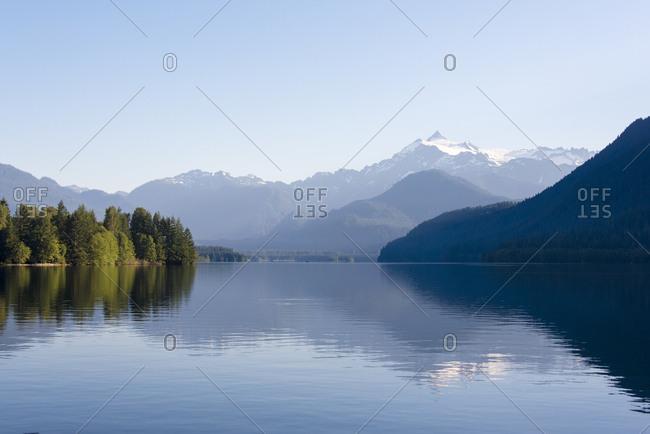 USA, Washington State. Mt. Shuksan reflected in morning light on calm Baker Lake