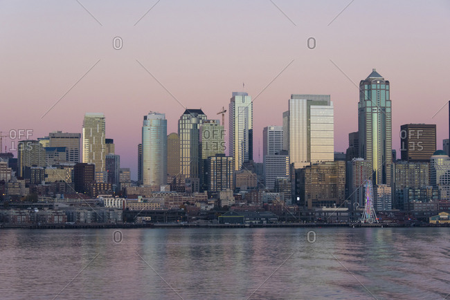 USA, North America, Washington - October 28, 2017: Twilight on Seattle skyline and Elliott Bay.