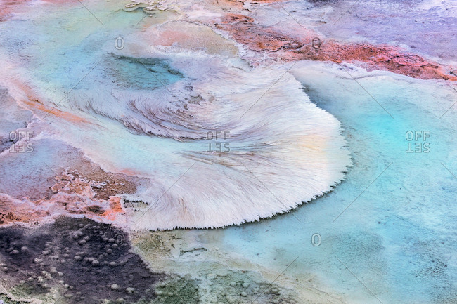Artistic patterns at New Blue Spring in winter in Yellowstone National Park, Wyoming, USA