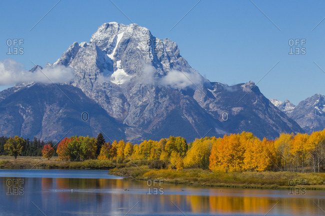 USA, Wyoming. Grand Teton National Park, fresh snowfall covers Mt. Moran on an autumn morning.