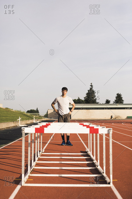 Young runner preparing for hurdle race