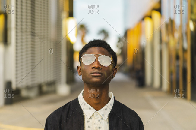 Portrait of a young black man- wearing a glasses