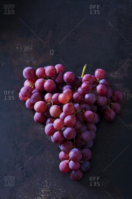 Blue grapes on dark metal