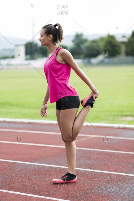 Teeanage runner warming up on race track