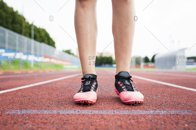 Feet of a runner- standing on race track