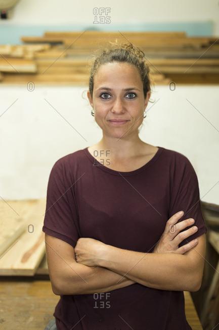Portrait of confident craftswoman in her workshop