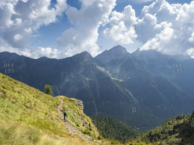 Italy- Lombardy- Valle di Scalve- hiker on hiking trail- Mount Camino