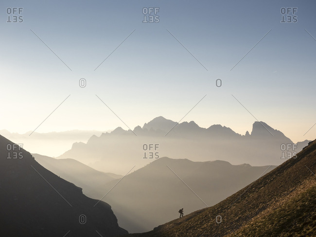 Italy- Lombardy- Bergamasque Alps- hiker on the way to Passo del Gatto- Cima Bagozza and Mount Camino
