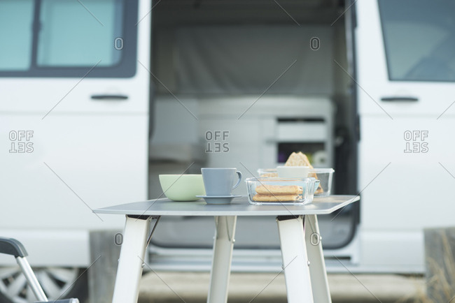 Van and laid breakfast table