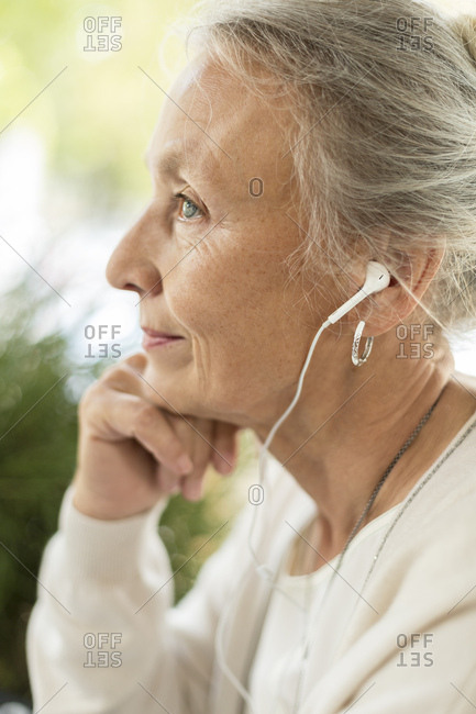 Profile view of senior woman with earphones