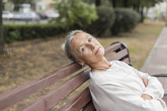 Portrait of senior woman relaxing on a bench