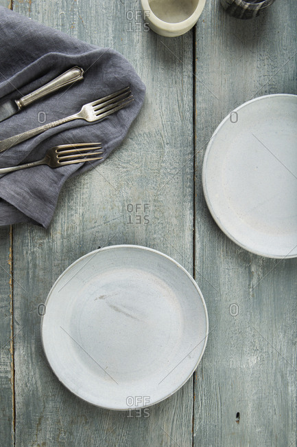 Plates and cutlery on rustic table