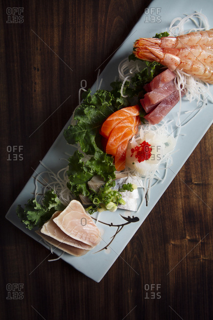 Fresh sashimi plated on a wooden table