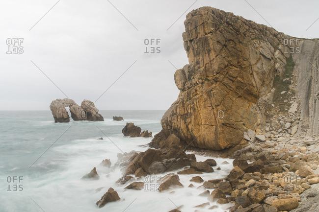 Rough rock in waving sea