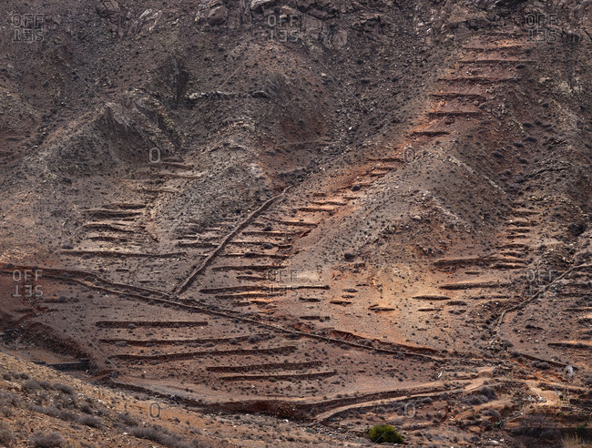 Aged damaged stairs going up on slope of wonderful mountain on Fuerteventura Island, Spain