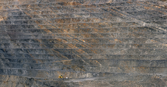 Rough surface of huge open pit of Santa Lucia Mine on sunny day in Leon, Spain