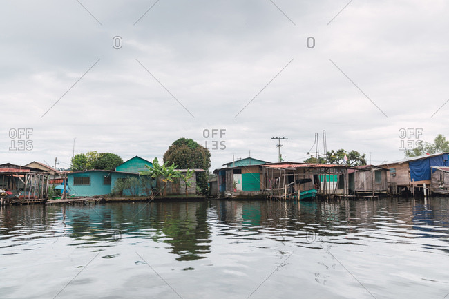 Poor small district of city with channel under cloudy sky, Panama