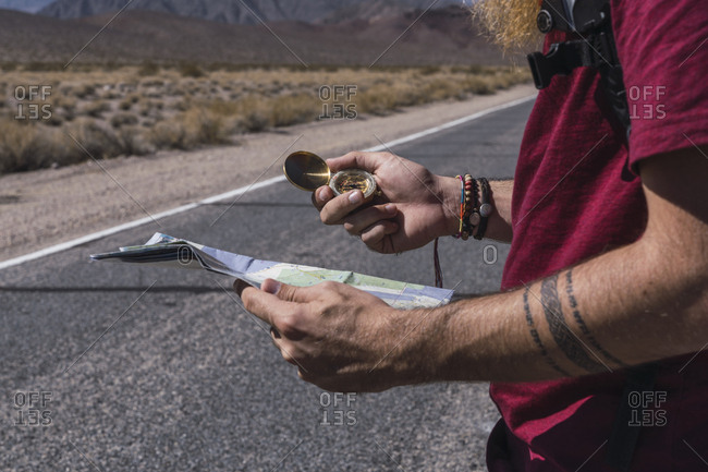 Man with paper going on road between death lands