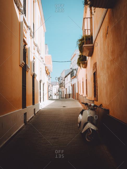 Narrow stone path going among amazing houses on street of Merida, Spain