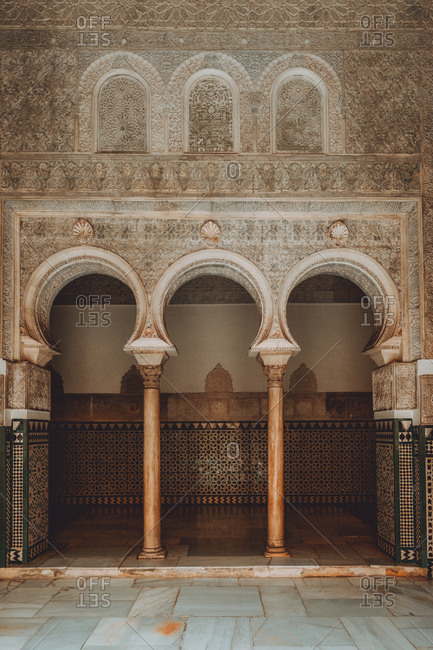December 28, 2018: View of amazing palace hall decorated with wonderful patterns in Seville, Spain