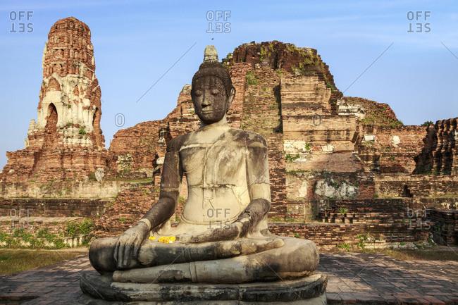 Ayutthaya, Thailand. Large Buddha at Wat Phra Mahathat, Ayutthaya Historical Park, near Bangkok