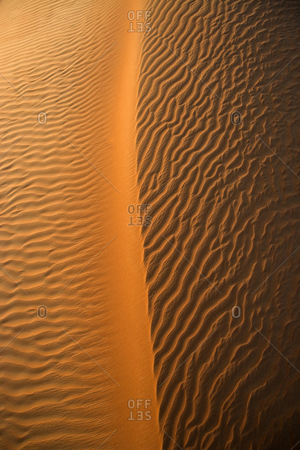 Aerial view of the sand dunes of the Arabian Desert next to Dubai, United Arab Emirates