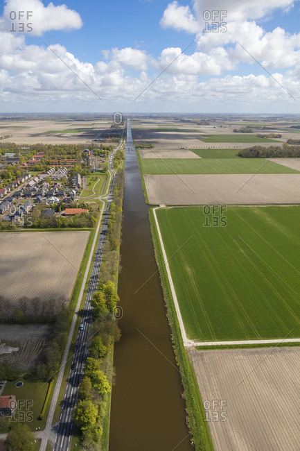 Long straight canal next to road, near Amsterdam, North Holland, Netherlands