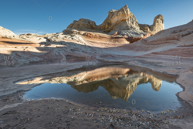Pool reflection and sandstone landscape, Vermillion Cliffs, White Pocket wilderness, Bureau of Land Management, Arizona