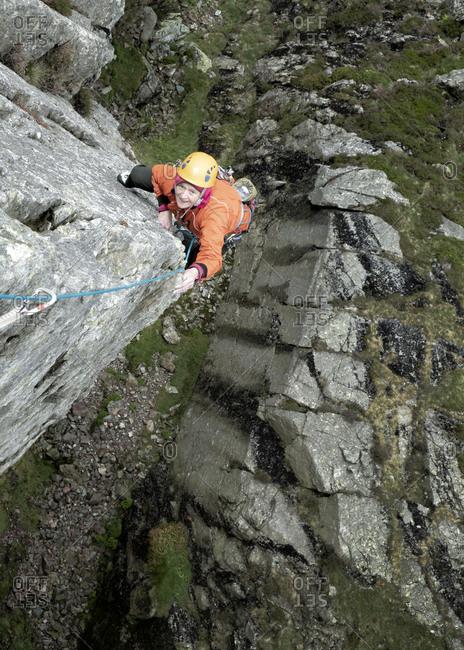England- Langdale Valley- Gimmer Crag- female climber on rock