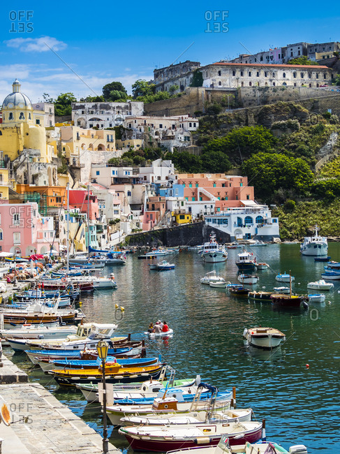 Italy - June 10, 2016: Italy- Campania- Gulf of Naples- Phlegraean Islands- Procida Island- Harbor- Marina di Corricella- former prison on mountain