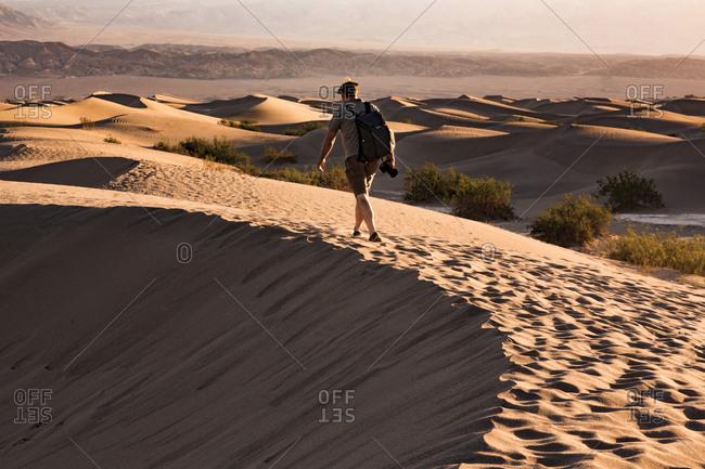 USA- Californian- Death Valley- Death Valley National Park- Mesquite Flat Sand Dunes- man walking on dune