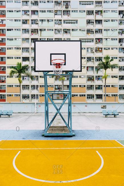 Hong Kong - November 21, 2018: Hong Kong- Kowloon- basketball hoop- public housing in the background